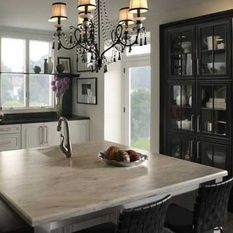 Oh Martha Stewart. Your Corian Countertops Are So Pretty! CJC: Think About  White Cabinets But Black For The Island.