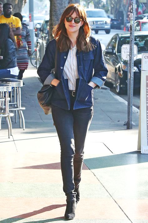 The 50 Shades of Grey star hits the streets in a dose of double denim with a military-inspired chambray jacket, and Tabitha Simmons boots.  Splash  - HarpersBAZAAR.com