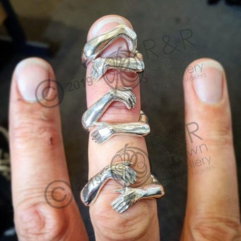 The original hug ring, copyright Richard Chown 2019. There are many, many copies of this ring available and being advertised now but by buying this one, you are supporting a very small business, who designs and makes everything in London, England. Check out our instagram www.instagram.com/randr_chown_jewellery to see behind the scenes photos, our other designs and custom work. 'Hug ring', designed to look like arms wrapping around your finger. Original design carved in wax then lost wax cast int