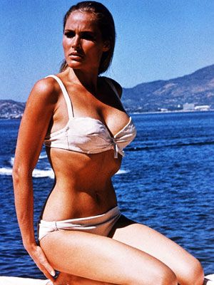 The History of the Bikini - 1962 Ursula Andress wears THAT white bikini in James Bond film Dr. No. Later that year Playboy puts a bikini on the cover.