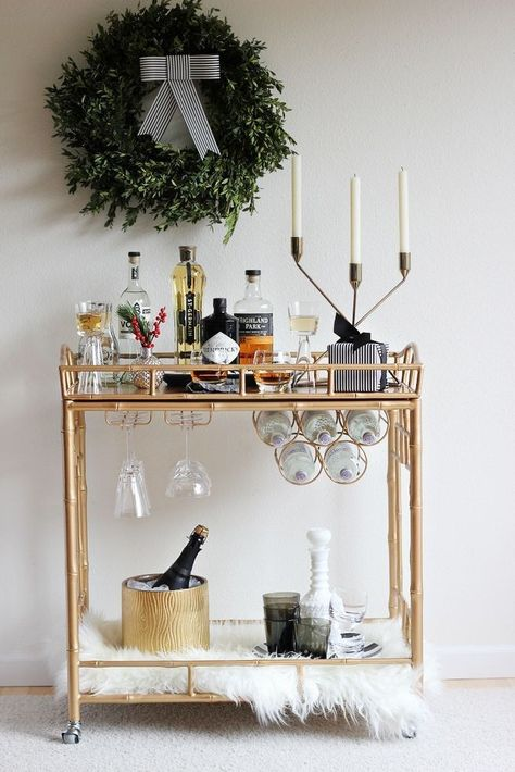 Sure, your bar cart is stocked and ready for guests, but don't forget to give a little zhuzh to the boozy furniture piece. Simply hang a wreath above the tallest bottles, throw a sheepskin throw onto the lower shelf, and you've got yourself one spirited set of wheels.