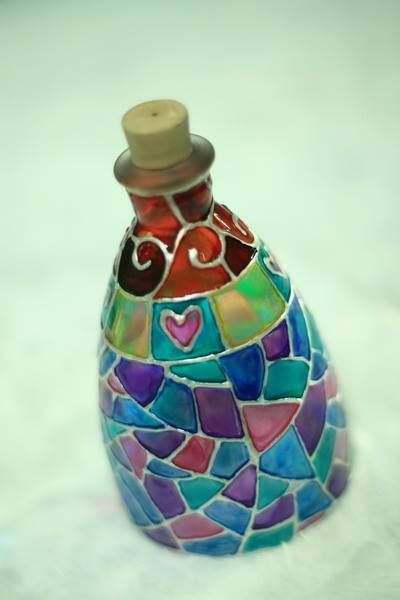 Repurpose a simple clear bottle with a stained glass effect! this is dazzling!