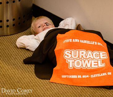 Custom produced Wedding Guest Favors - Wedding Fan Towels for Cleveland Browns Fans.  Order yours from SportsThemedWeddings.com today!  #footballwedding  #stwdotcom