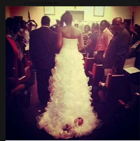 WHAT NOT TO DO ON YOUR WEDDING DAY!! In a picture circulating around Facebook, we see a bride literally drags her baby down the aisle on the train of her wedding dress. Problem.
