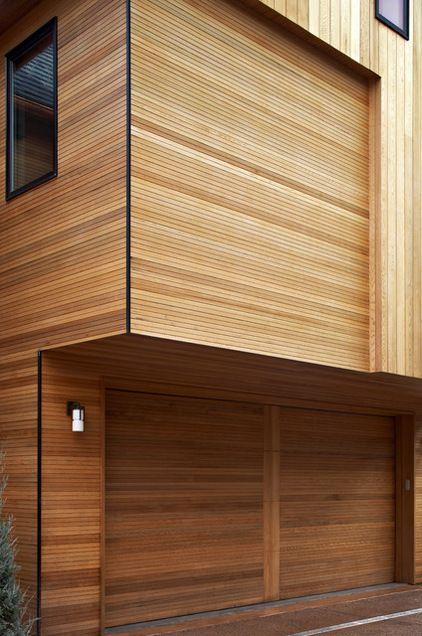 Hidden garage door! contemporary entry by Daniel Marshall Architect