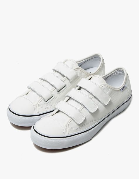 812845efea90 Retro-inspired sneaker from Vans in White. Textured leather upper. Three  strap Velcro closure. Logo detailing at left ankle and heel. Canvas lining.