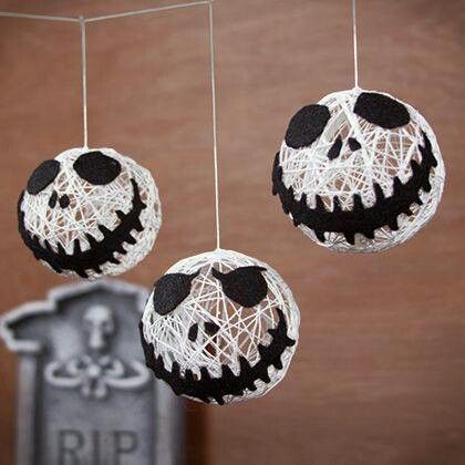 I could do this. Put string in paper mâché mix, cover little balloons. When dry paint string white and add faces.