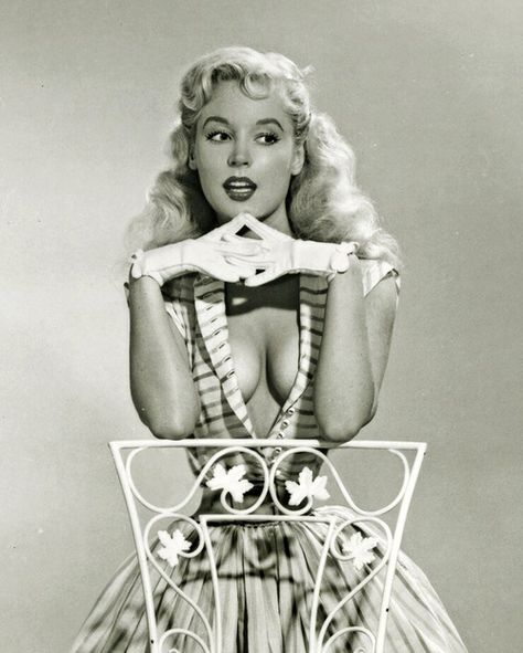 Betty Brosmer, its not what you wear to dinner with your grandparents, but it's got its possibilities
