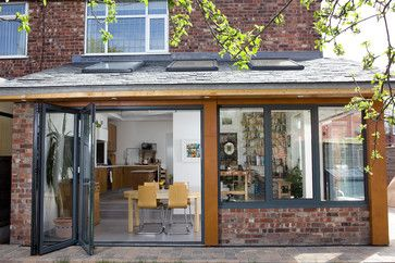 Very nice rear extension. Timber posts break up panels of brick and glass. www.methodstudio.london