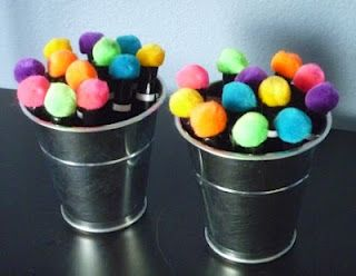 Pom Poms glued onto dry erase marker caps = instant erasers! :-)