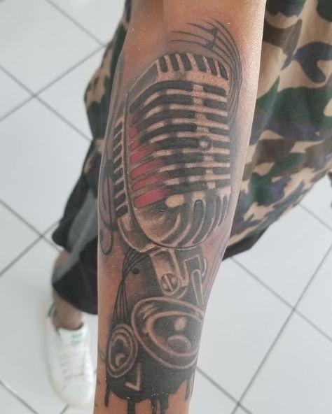 Art by Roge.     #music #musictattoo #tattoo #tattoos #tattoolovers #tattooed #ink #art #inked #tattoostudio #tattooandpiercing #tattoofiesta #duluth #georgia #duluthtattoo #artists #artist #Roge