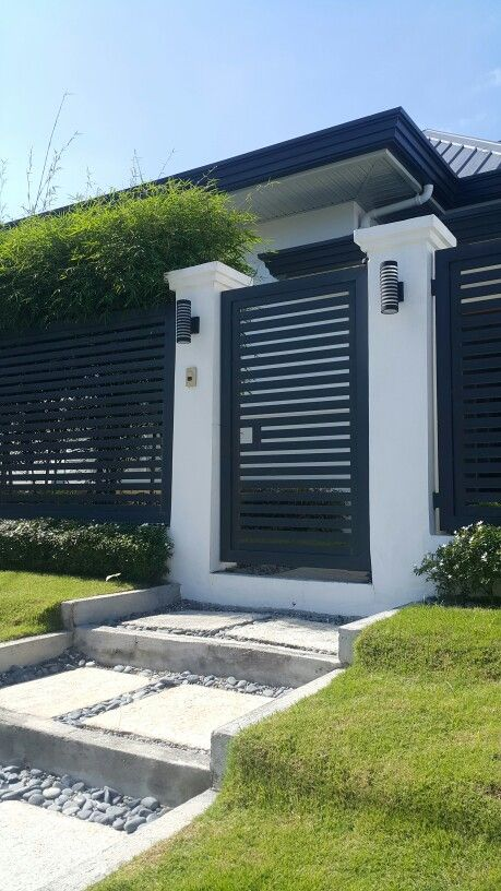 Modern Minimalist Facade With Clean Lines And Dark Gray White And Green House Fence Design House Gate Design Door Gate Design