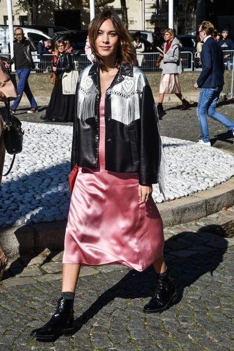 Alexa Chung arrived for the Miu Miu show in a pink slip dress with ankle boots and a fringed leather jacket.