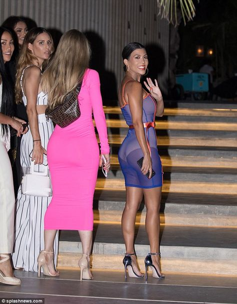 Kourtney Kardashian puts her curves on parade in sheer dress