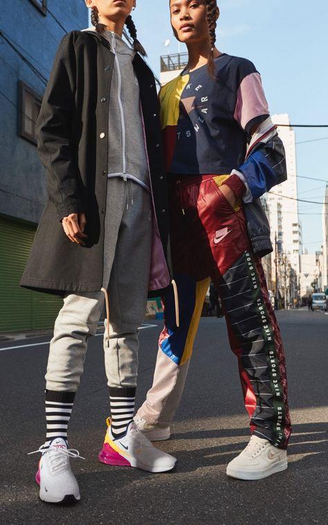 Two girls wearing the Nike Women's Sportswear Pack