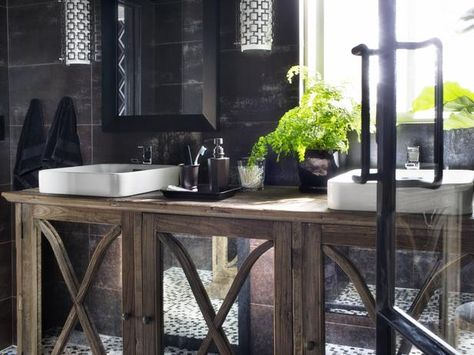 This mirrored console table is meant for a dining room but it's also stunning in the bathroom.