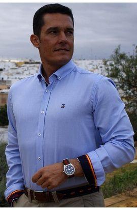 Camisa azul con coderas al contraste y la bandera de España