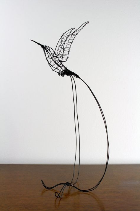 A wire hummingbird sculpture makes a bird-lover's heart sing. #etsy #etsyfinds