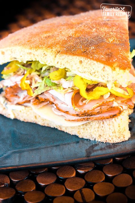 They make this Turkey Over Italy Turkey Sandwich at my favorite deli in Boise called Deli George. It has turkey, provolone, and pesto mayo on focaccia bread. #turkeyoveritaly #turkeysandwich #sandwich #turkeyandprovolone #deli #FavoriteFamilyRecipes #favfamilyrecipes #FavoriteRecipes #FamilyRecipes #recipes #recipe #food #cooking #HomeMade #RecipeIdeas
