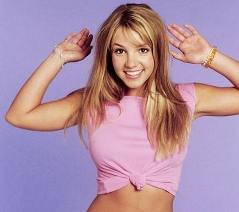 Britney Spears poses during a portrait session on May 1999 in Los Angeles, California.