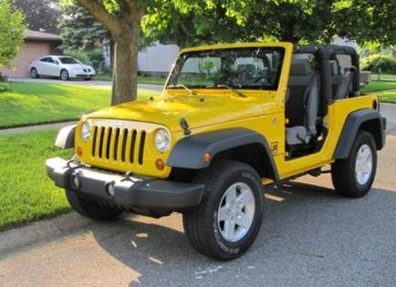 Yellow 4 Door Jeep Jk With Great Looking Wheels Yellow Jeep