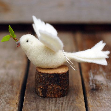 A message of peace for any season~ Our peace doves are needle felted out of white wool. Each bird has black bead eyes, a wrapped grey beak, and a small wire and wool olive branch held in its beak. Birds measure almost 6 inches long and have a gold thread hanger. We will choose a