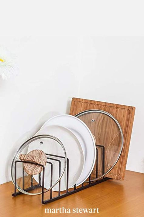 Similar to file holders used in offices (but sturdier), these simple but strong iron racks are useful if you store pans in a deep drawer or a pantry. They're less useful for storage in a cupboard unless you have a shelf to dedicate to lid storage or a pull-out cupboard, lids stored at the back will be hard to reach. #marthastewart #organization #kitchentips #kitchenorganizationideas