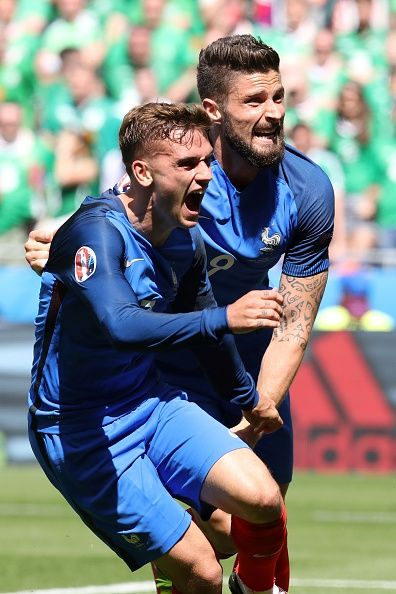 #EURO2016 France's forward Antoine Griezmann celebrates scoring a goal with France's forward Olivier Giroud during the Euro 2016 round of 16 football match...