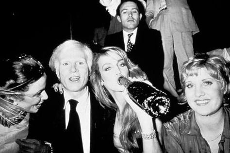 Andy Warhol with Jerry Hall at Studio 54