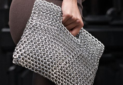 Hand held cut-out clutch purse. Winner of the 2010 Independent Handbag Designer Award for Best Green Handbag. Beautifully finished with silver fabric liner, zipper closure.