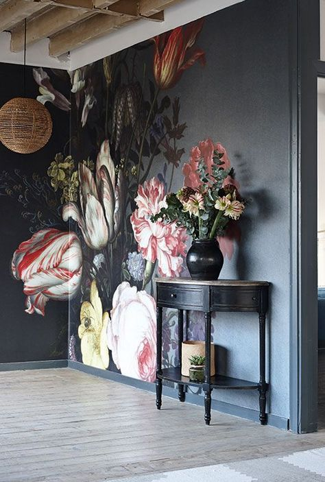 Large bold floral designs on a dark background, can give a dramatic effect. Match accessories in similar shades to pull the look throughout your home.