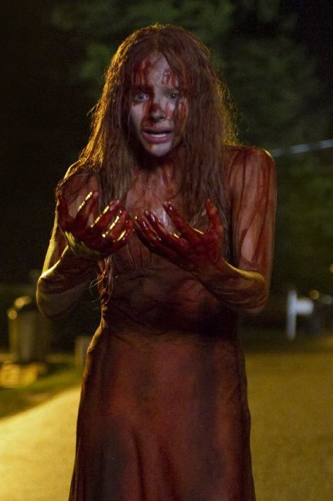Pin for Later: 450 Pop Culture Halloween Costume Ideas Carrie White From Carrie  What to wear: A pink prom dress covered in fake blood. How to act: Give people an intense look as you mentally strike them down.