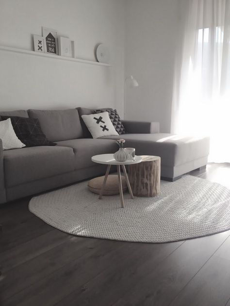 Awesome Light Earth Tone Rug Dark Hardwood Floors And Grey Sofa In Gmtry Best Dining Table And Chair Ideas Images Gmtryco