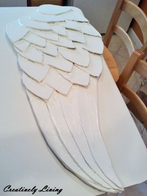 Beautiful Large Angel Wing Tutorial with paper mache and spray paint by Creatively Living