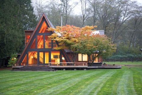 A-frame with smaller bump-out to one side & large addition to the other side.