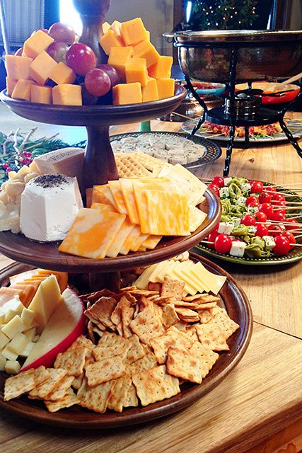 Cheese and crackers arranged on tiered platter