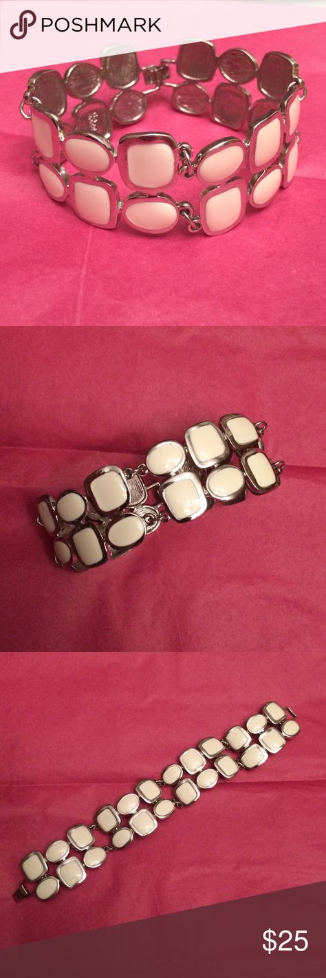 """Lia Sophia White & Silver Bracelet-Like New! Lia Sophia White & Silver Bracelet-Like New! This bracelet is great and goes with everything. Dress up or down. Worn twice. Smoke free home. Make a reasonable offer and I will be happy to accept!  Approx 8"""" end to end. So t miss this one! Lia Sophia Jewelry Bracelets"""