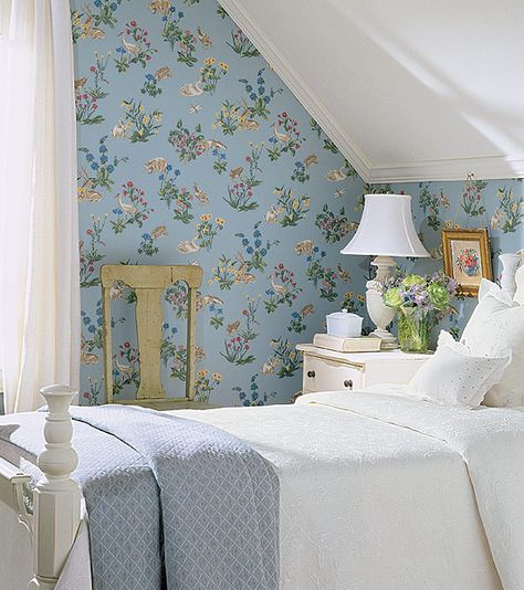 Love attic rooms or rooms with slanted ceilings.  They were just made for a charming wallpaper like this Thibaut paper.