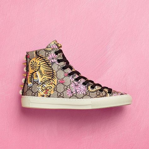 525fce35fdf The  GucciBengal high-top sneaker features a grosgrain House Web stripe on  the back embellished with studs and pearls.  GucciCruise17