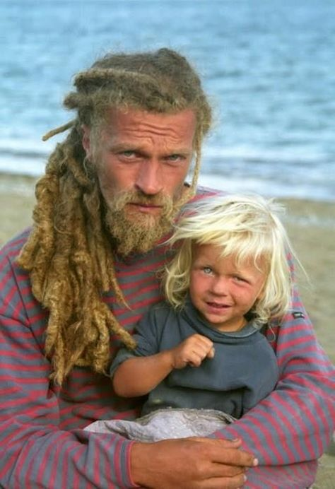 I'm not normally into dreads on white guys, but this guy- he rocks them. Gorgeous father and son photo!