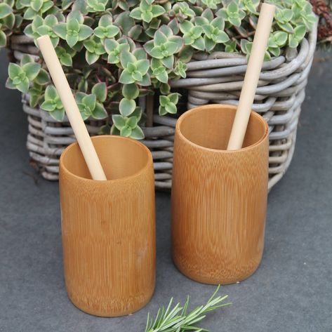 Eco Friendly Natural Bamboo Cup is completley natural, great fun and perfect for taking outdoors. This set of two comes with 2 x beakers, 2 x straws, one cleaner. They come wrapped in a colourful tissue and packe in all recycled kraft paper and tape.  The bamboo wood is used to create our 330ml Bamboo Cups is sourced from readily and naturally available bamboo wood and is presented in the natural bamboo colour. Sourced ethically at a fair price. They are great fun can be used for camping, al fre