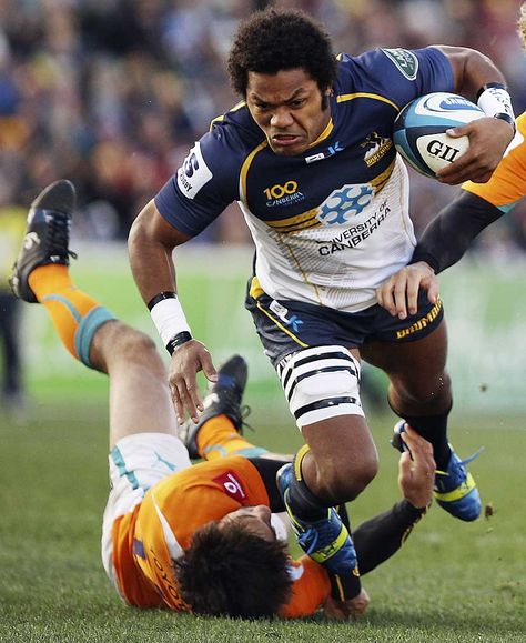 The Brumbies' Henry Speight runs through a tackle