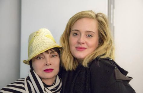 Here she is posing with some lady named Adele* while on tour with Bette Midler…