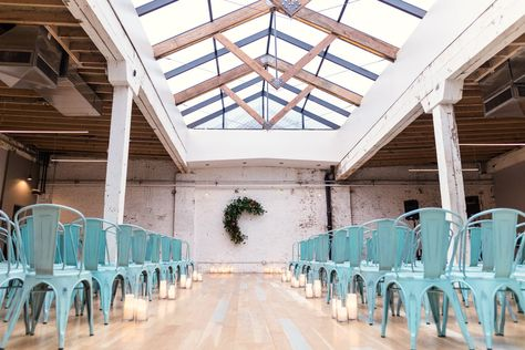 Boho-chic candlelight wedding ceremony space with skylight at The Joinery Chicago