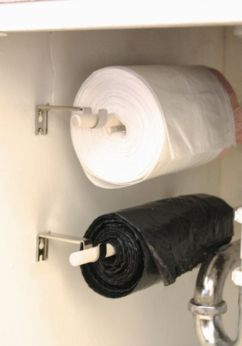 Trash Bags on a Roll. Good idea for inside the pantry or garage. Be sure to bolt to a wall stud for proper weight support.