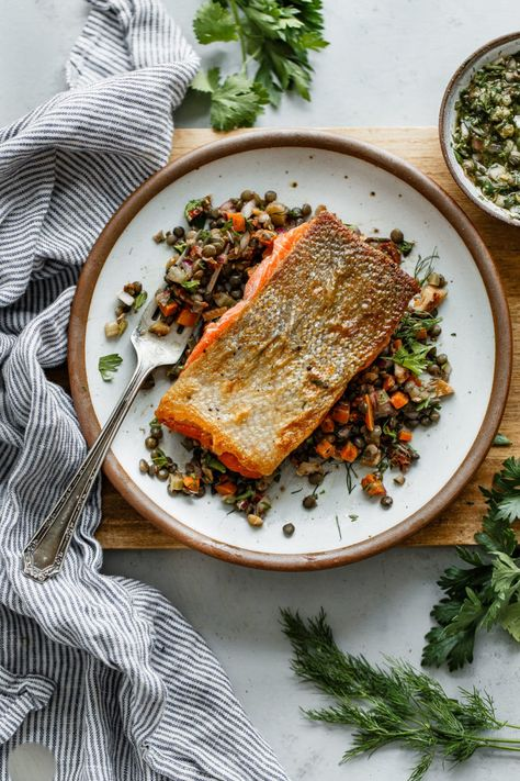 Pan Seared Salmon with Lentils (How to Pan Sear Salmon) - A Beautiful Plate #searedsalmonrecipes Pan Seared Salmon with Lentils - crispy pan seared salmon topped with a zesty caper herb vinaigrette and served alongside a flavorful French lentil salad. #sponsored #salmon #lentils #abeautifulplate #recipe #healthy #dinner #glutenfree #dairyfree #searedsalmonrecipes Pan Seared Salmon with Lentils (How to Pan Sear Salmon) - A Beautiful Plate #searedsalmonrecipes Pan Seared Salmon with Lentils - cris