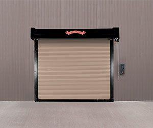 Everserve Is A Rolling Door System With A Springless Barrel Design Featuring Integrated Shafts Doors And Hardware Steel Garage Doors Door Insulation