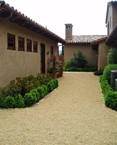 Dog run w/ pea gravel and shrubs