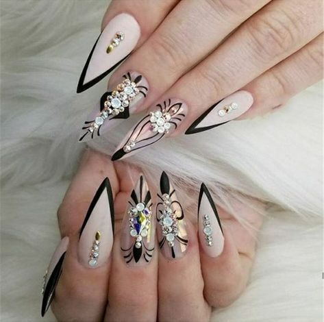 Almond shaped nails with black line art, lots of rhinestones, and nude gel polihs, Edgy and fun! Beautiful nails by Ugly Duckling Nails page is dedicated to promoting quality, inspirational nails created by International Nail Artists