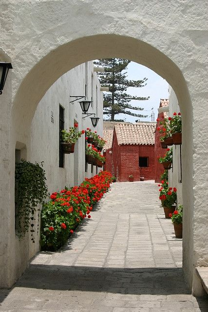 """visitheworld: """" Picturesque alley at Santa Catalina Convent in Arequipa, Peru (by Four Seasons Garden)."""